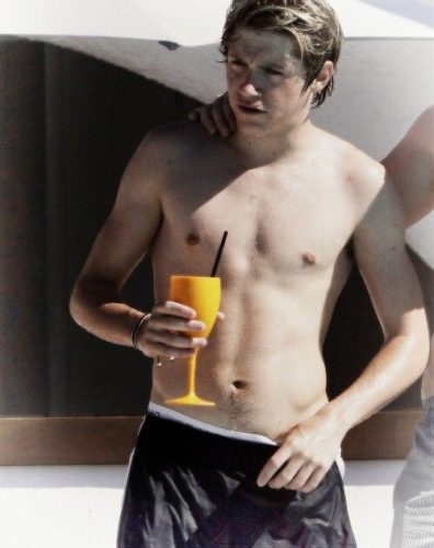 Shirtless Niall Horan Relaxes Poolside in Cabo After